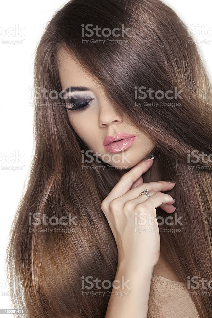 Hairstyling. Beautiful Brunette Girl. Healthy Long Brown Hair. Beauty royalty-free stock photo