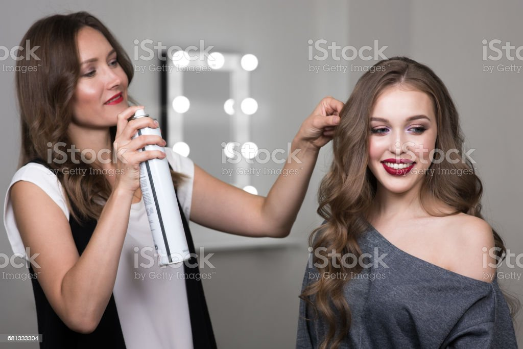 Hairstylist and model in beauty studio stock photo
