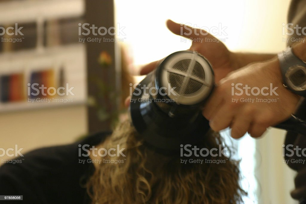 Hairstylist with blowdryer royalty-free stock photo
