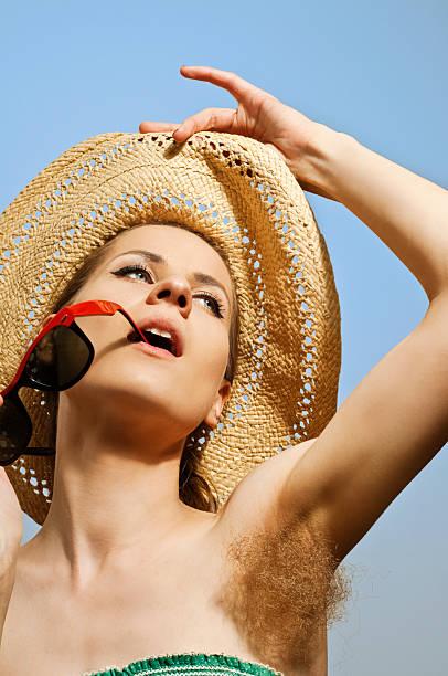 hairy armpit stock photo
