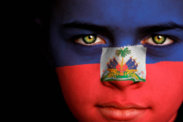 Haiti Boy Portrait of a boy with flag of Haiti painted on his face Haiti Flag stock pictures, royalty-free photos & images