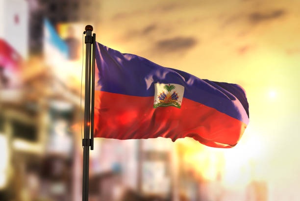 Haiti Flag Against City Blurred Background At Sunrise Backlight Haiti Flag Against City Blurred Background At Sunrise Backlight Haiti Flag stock pictures, royalty-free photos & images