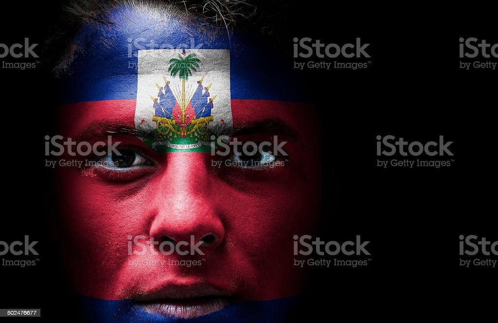 Haiti flag on face stock photo