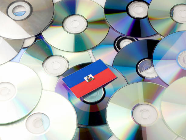 Haiti flag on top of CD and DVD pile isolated on white Haiti flag on top of CD and DVD pile isolated on white Haiti Flag stock pictures, royalty-free photos & images