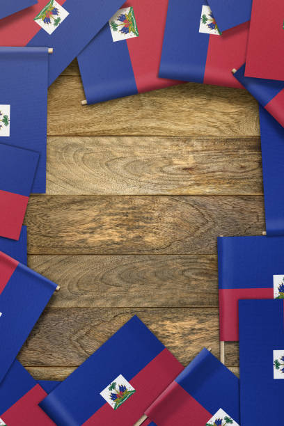 Haiti Flag small flags framing a wood texture background with copy space Haiti Flag stock pictures, royalty-free photos & images
