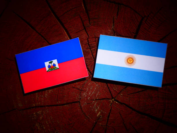 Haiti flag with Argentinian flag on a tree stump isolated Haiti flag with Argentinian flag on a tree stump isolated Haiti Flag stock pictures, royalty-free photos & images