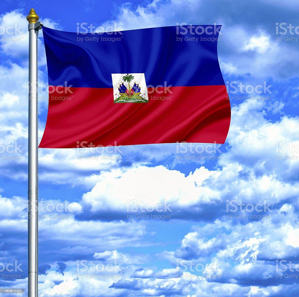 Haiti waving flag against blue sky stock photo