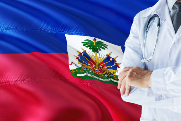 Haitian Doctor standing with stethoscope on Haiti flag background. National healthcare system concept, medical theme.Haitian Doctor standing with stethoscope on Haiti flag background. National healthcare system concept, medical theme.Haitian Doctor standi Haitian Doctor standing with stethoscope on Haiti flag background. National healthcare system concept, medical theme. Haiti Flag stock pictures, royalty-free photos & images