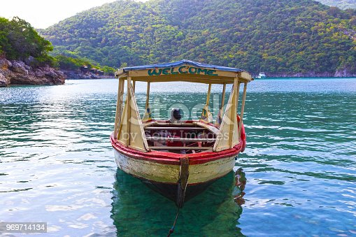 istock Haitian Fishing Boat: An old fishing boat near Labadee 969714134