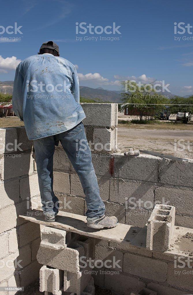 Haitian man is bringen up walls royalty-free stock photo