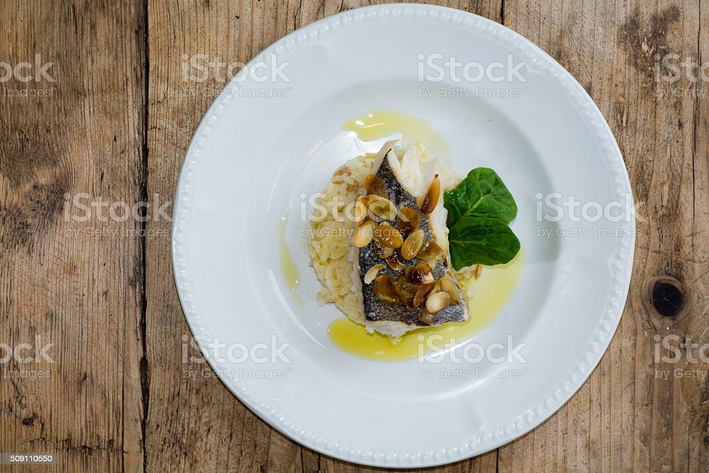 Hake and almond risotto from above stock photo