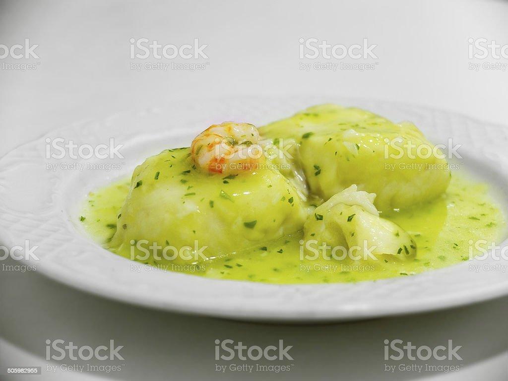 Hake in green sauce. stock photo