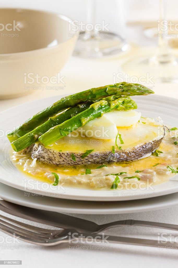 Hake with asparagus stock photo