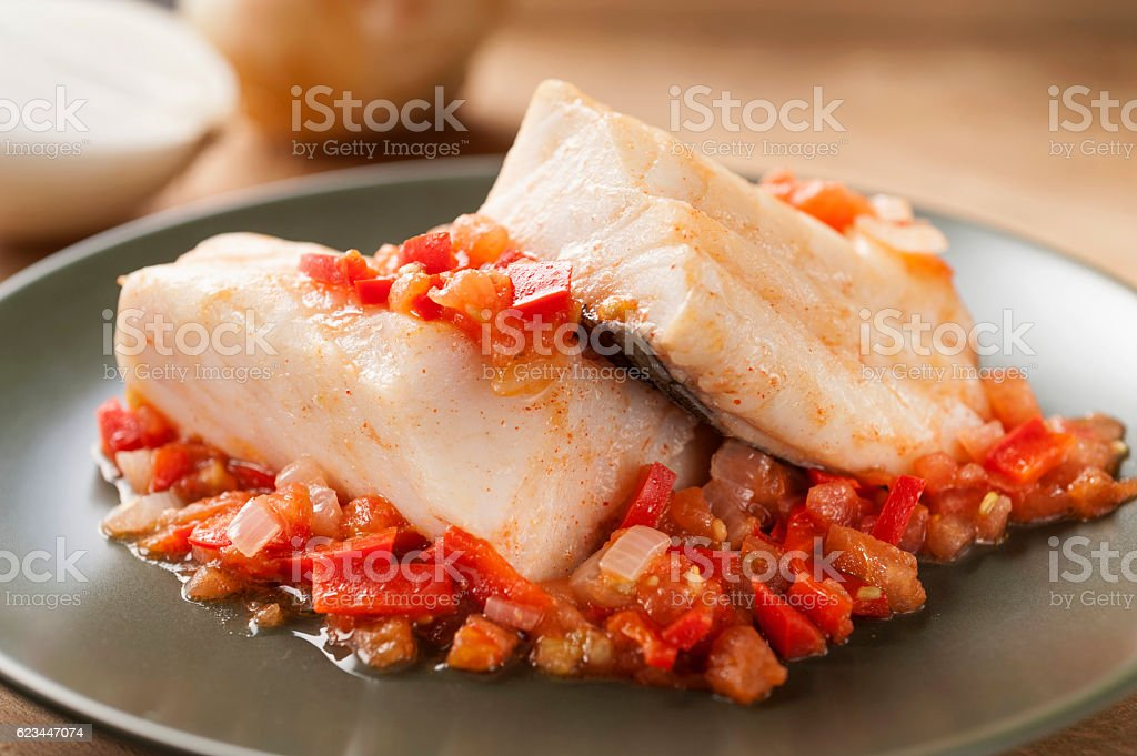 hake with onion stock photo