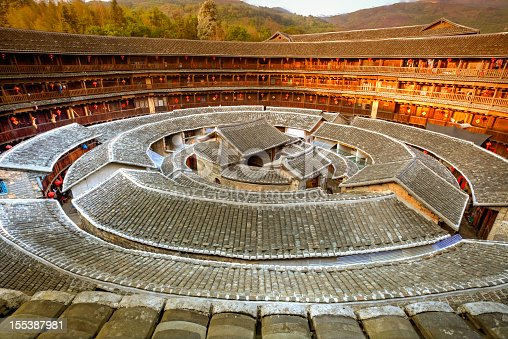 Fujian Tulou (or Earth Houses) are traditional housing in Hakka Villages in Fujian Province of China. The largest Tulou formally hosted 600 people  They have been classified in 2008 as World Heritage by the UNESCO.   [url=http://www.istockphoto.com/search/lightbox/12058248#1950594e][img]https://dl.dropbox.com/u/61342260/istock%20Lightboxes/Shanghai.jpg[/img][/url]  [url=http://www.istockphoto.com/file_search.php?action=file&lightboxID=6668404&refnum=fototrav][img]https://dl.dropbox.com/u/61342260/istock%20Lightboxes/p505501680.jpg[/img][/url]  [url=http://www.istockphoto.com/search/lightbox/12650990#a7d4d9b][img]https://dl.dropbox.com/u/61342260/istock%20Lightboxes/Skyline.jpg[/img][/url]  [url=http://www.istockphoto.com/search/lightbox/7990705/?refnum=fototrav#1609603d][img]http://bit.ly/13poUtx[/img][/url]  [url=http://www.istockphoto.com/search/lightbox/7294633/?refnum=fototrav#b7fe73b][img]https://dl.dropbox.com/u/61342260/istock%20Lightboxes/Night2.jpg[/img][/url]   [url=file_closeup.php?id=15048537][img]file_thumbview_approve.php?size=1&id=15048537[/img][/url] [url=file_closeup.php?id=14897045][img]file_thumbview_approve.php?size=1&id=14897045[/img][/url] [url=file_closeup.php?id=16480530][img]file_thumbview_approve.php?size=1&id=16480530[/img][/url] [url=file_closeup.php?id=15453450][img]file_thumbview_approve.php?size=1&id=15453450[/img][/url] [url=file_closeup.php?id=16460117][img]file_thumbview_approve.php?size=1&id=16460117[/img][/url] [url=file_closeup.php?id=15284820][img]file_thumbview_approve.php?size=1&id=15284820[/img][/url] [url=file_closeup.php?id=16448072][img]file_thumbview_approve.php?size=1&id=16448072[/img][/url]