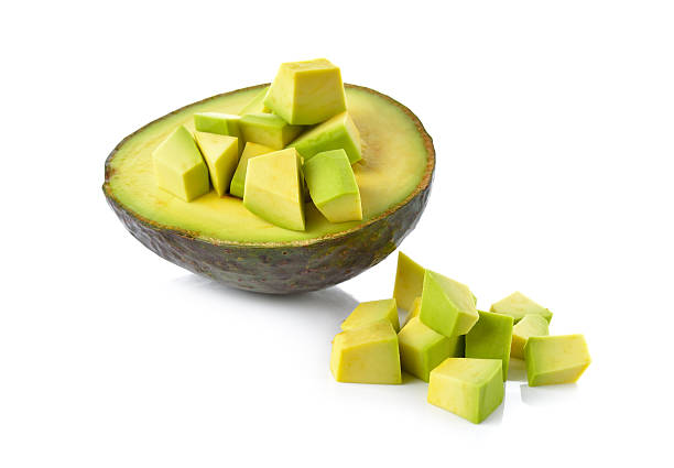 half and portion cut Avocado on white background stock photo