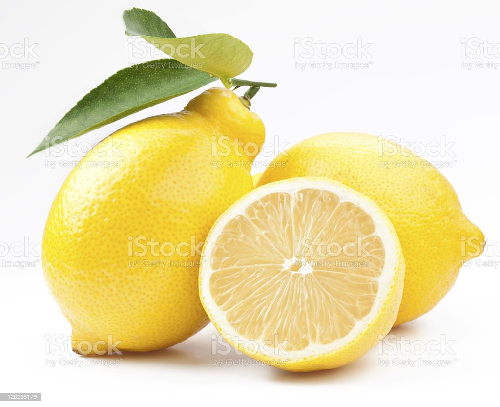Half and whole lemons against white background stock photo