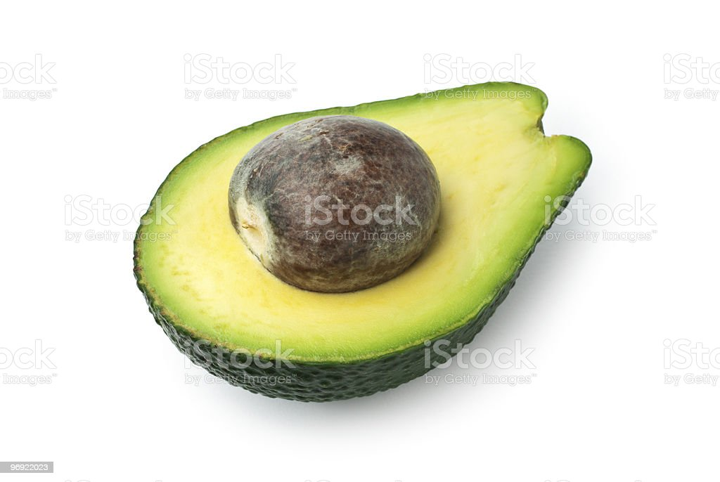 Half avocado with seed isolated on white royalty-free stock photo