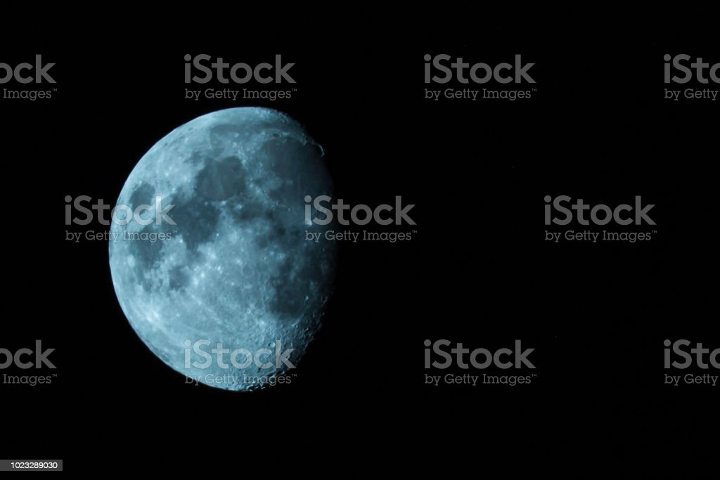 half blue moon black sky night photography