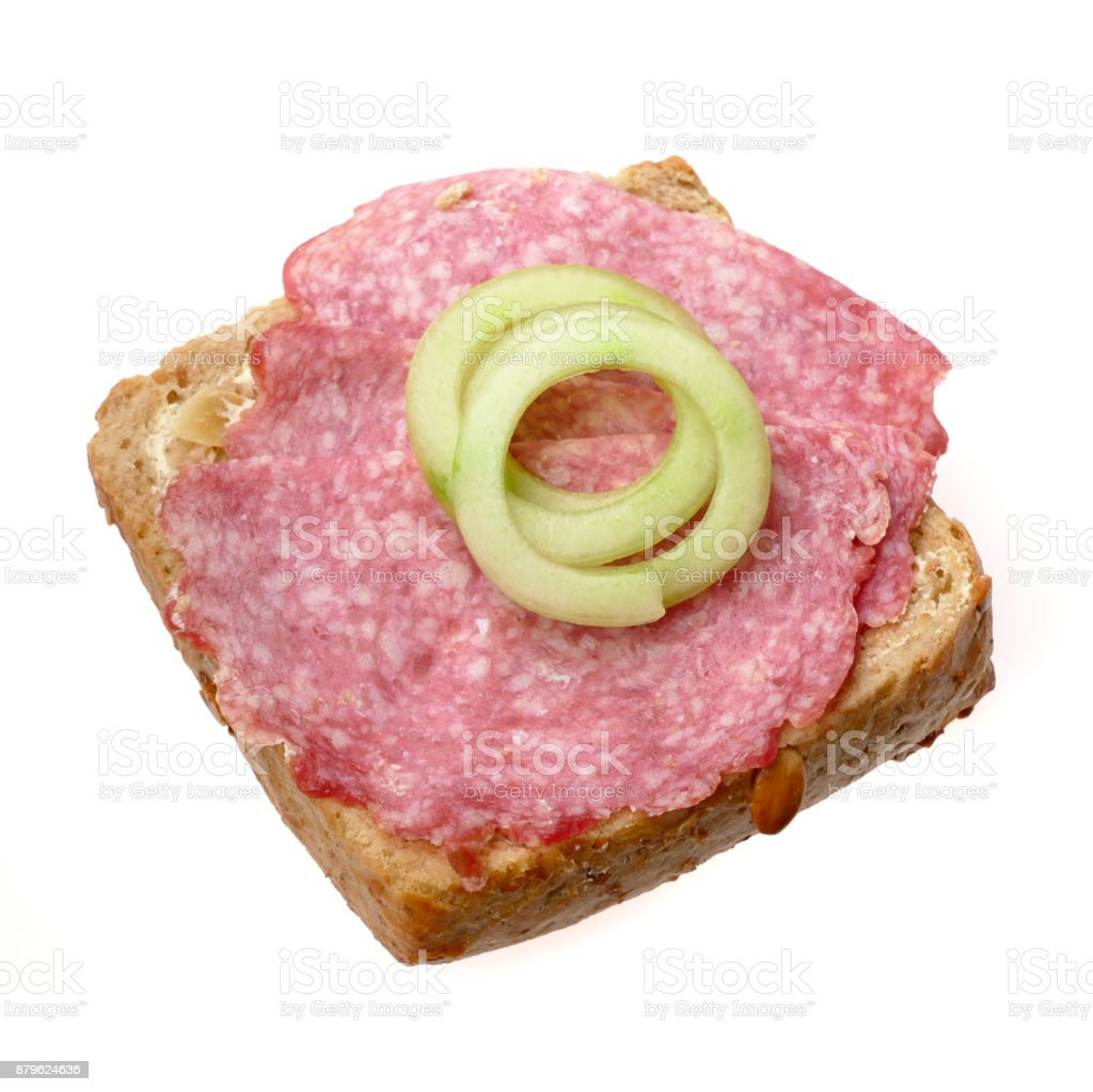 Half bun with salami decorated with cucumber isolated on white stock photo