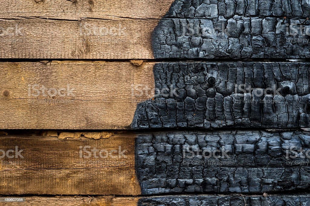 Half charred wood stock photo