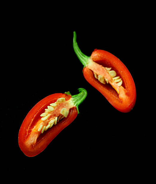 Half Chili on black stock photo