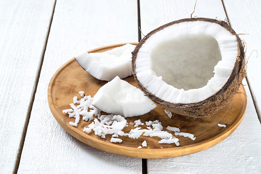 istock Half coconut, pieces of pulp and fresh shavings 500779942