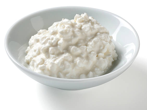 Half Cup serving of Cottage Cheese, white background Half cup serving of low fat cottage cheese in a bowl on a white background with natural shadow.Shot with a Nikon D3X.My Food Lightboxes burwellphotography stock pictures, royalty-free photos & images