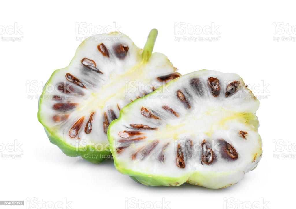 half cut of noni fruit isolated on white background stock photo