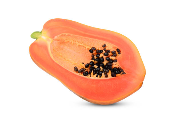 half cut of ripe papaya with seeds isolated on white background stock photo