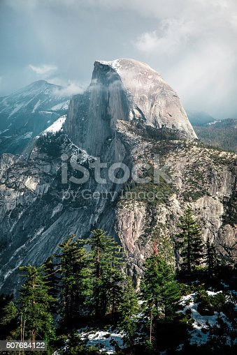 Clouds roll in over Half Dome on a stormy day in Yosemite National Park