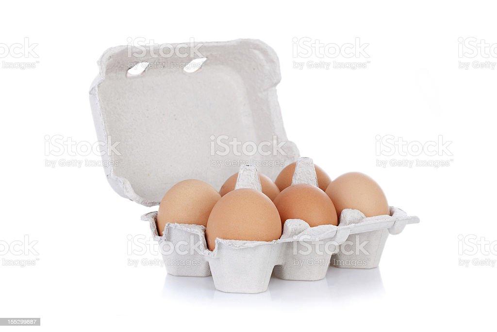 Half dozen brown chicken eggs in box stock photo
