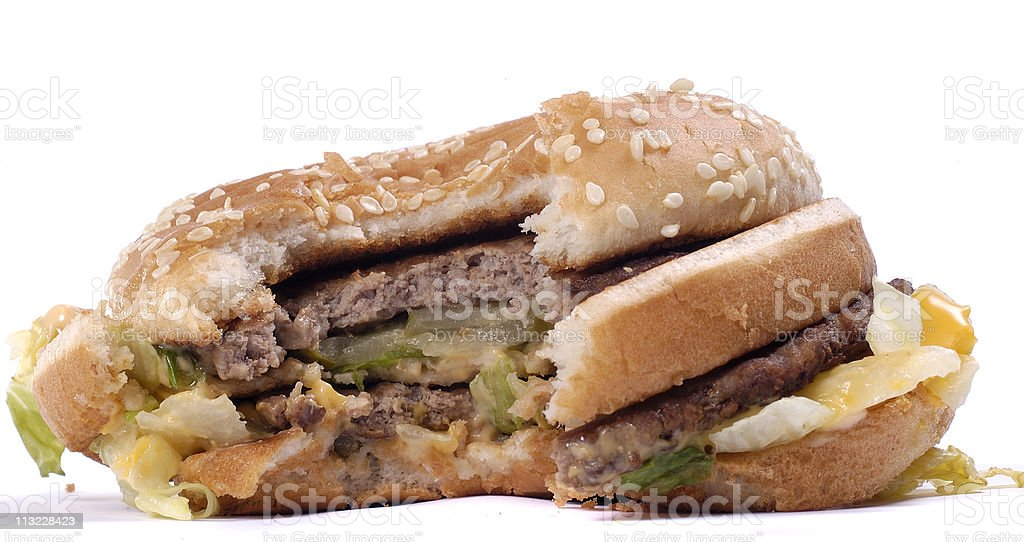 half eaten beef burger against white stock photo