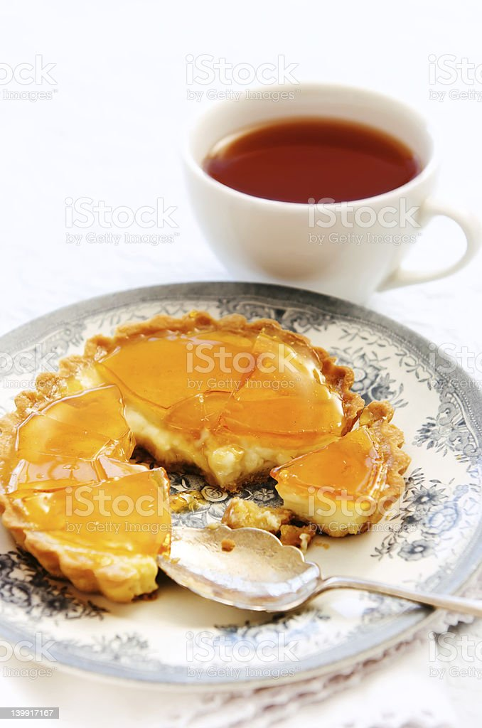 Half eaten custard tart royalty-free stock photo