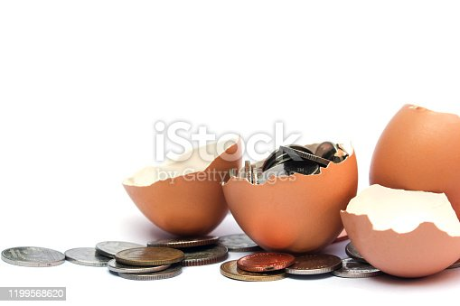 Half egg shell and coin, isolated on white background.In the concept of making money easily from eggs