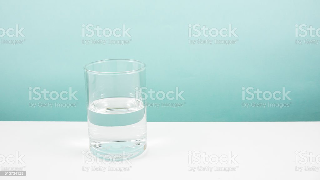 Half empty or half full glass of water stock photo