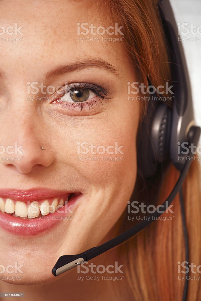Half face of a woman with head set. royalty-free stock photo