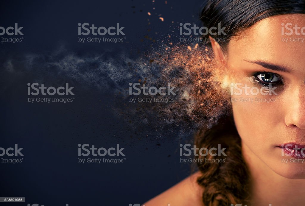Half face of a young woman in tears stock photo