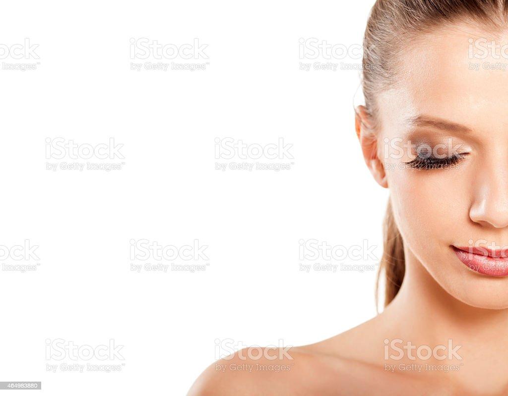 Half Face Of Smiling Beautiful Blonde With False Eyelashes Stock