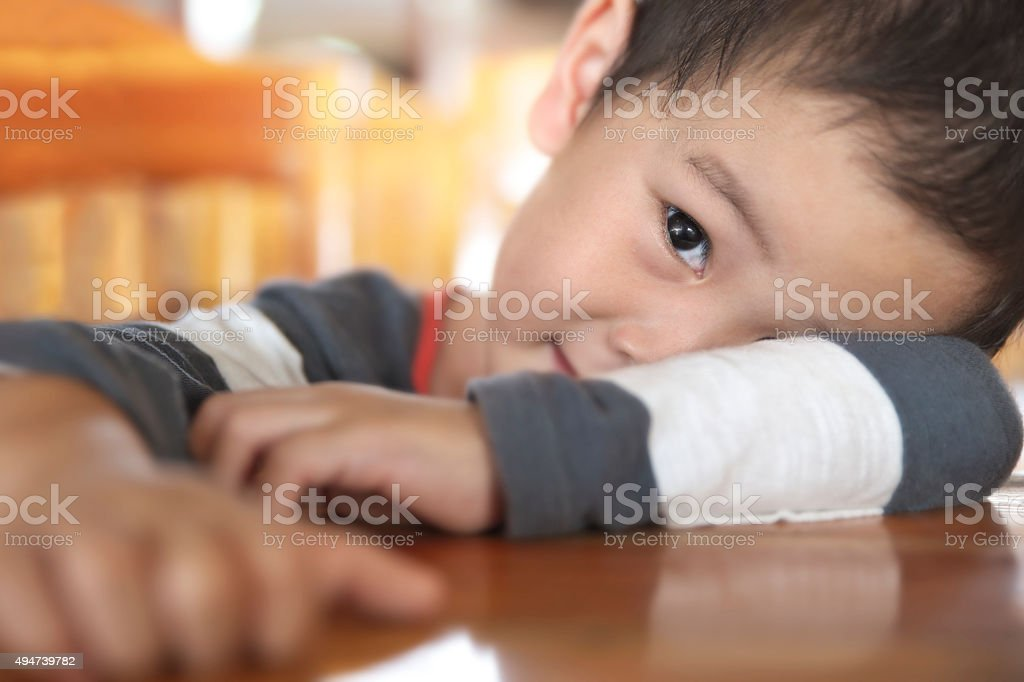 Half face of smiling Thai boy stock photo