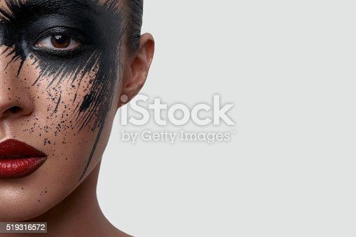 istock Half Face Portrait of Woman with creative Makeup 519316572
