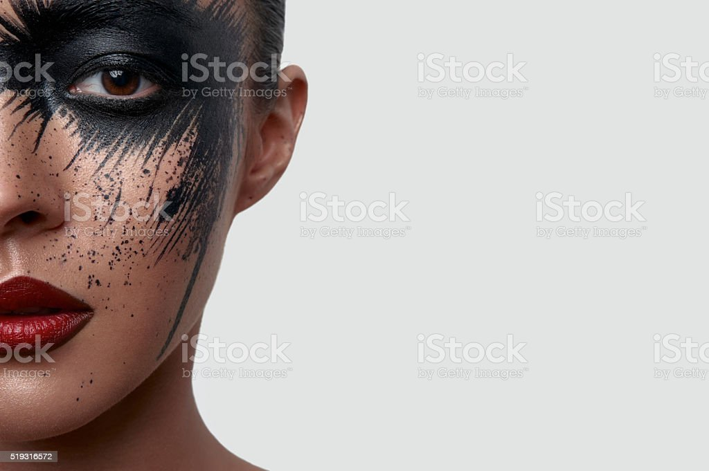 Half Face Portrait of Woman with creative Makeup stock photo