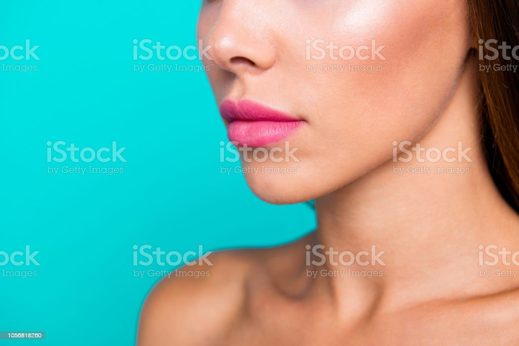 Half faced turned close up studio photo portrait of charming pretty attractive lady with perfect nice soft moisturized skin isolated on blue bright background stock photo
