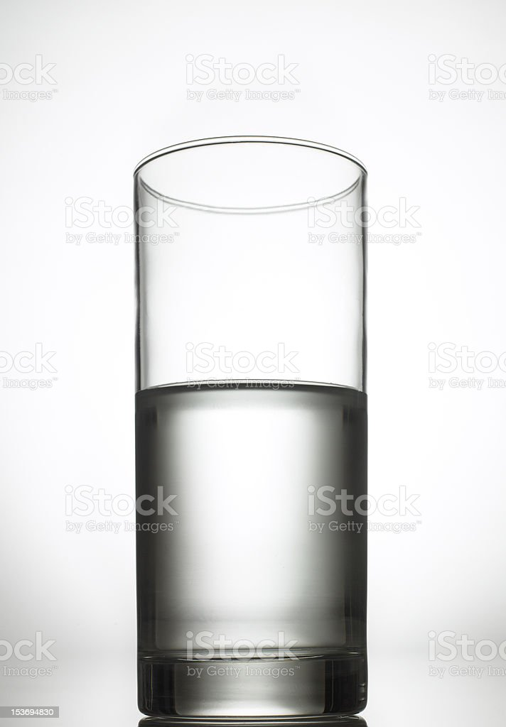 Half filled glass of water royalty-free stock photo