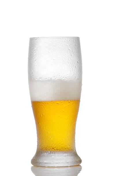 Half full  beer glass stock photo