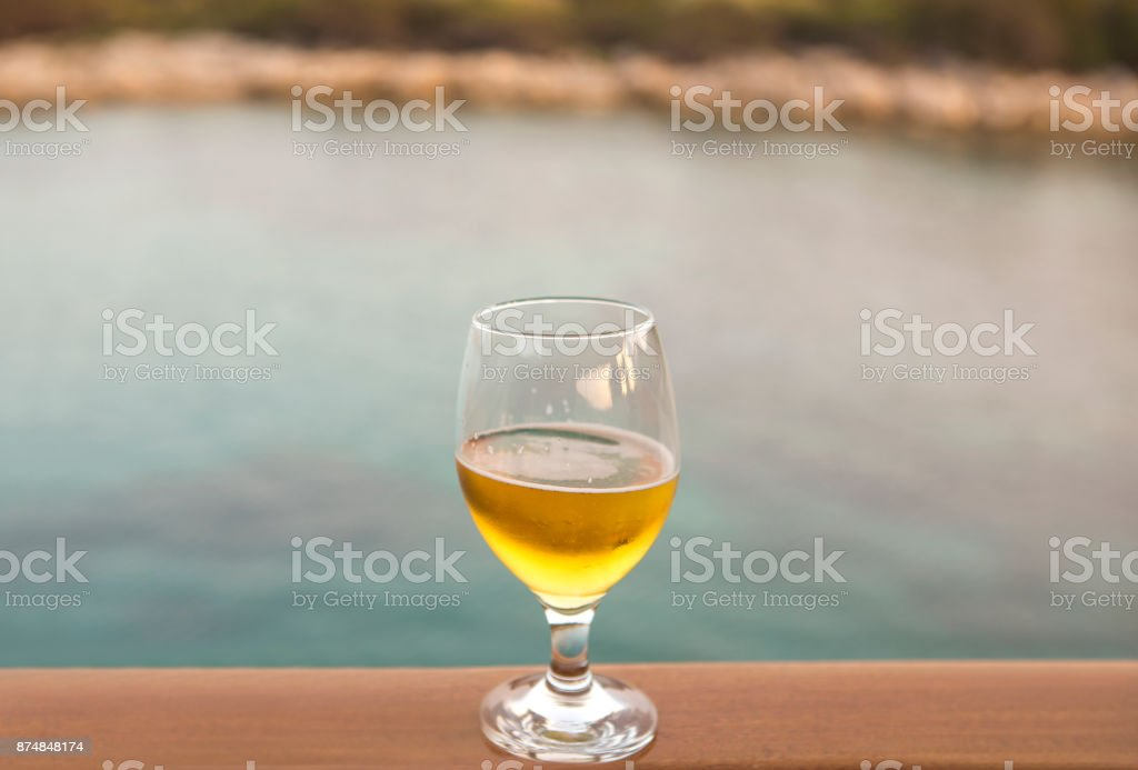 half full cold beer glass cup at wooden goulette near bodrum mugla turkey stock photo