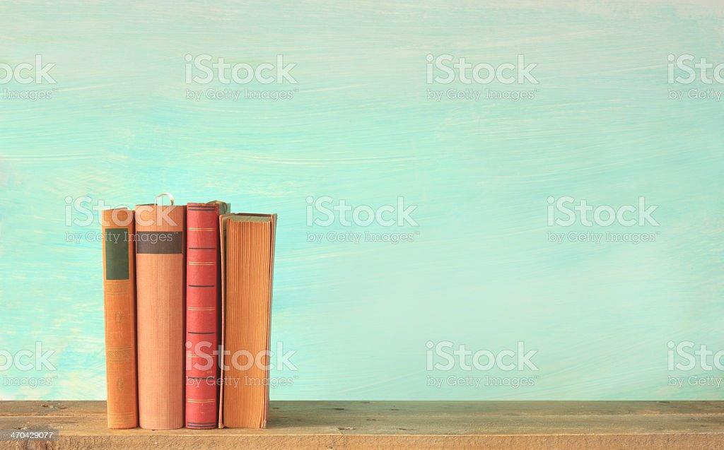 Half full shelf with books and half empty shelf stock photo