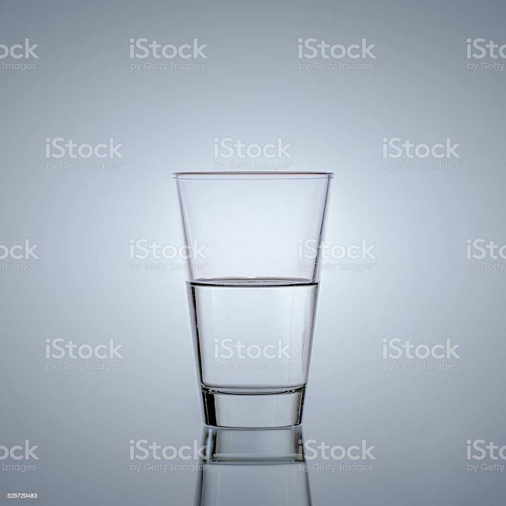 Half glass of water stock photo