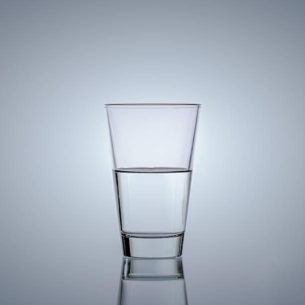 Half glass of water stock photo