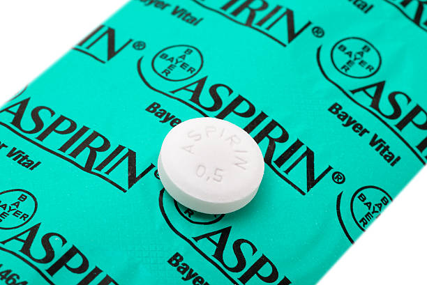 Half gram Aspirin tablet on backside of its blister pack stock photo